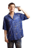 Guy in the blue shirt series. Guy in the blue shirt close his eyes and going to kill himself with a gun over white background Royalty Free Stock Photo