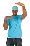 Guy in a blue t-shirt making a frame with his arms Royalty Free Stock Image