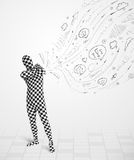 Guy in body suit morphsuit looking at sketches and doodles Royalty Free Stock Photo