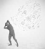 Guy in body suit morphsuit looking at sketches and doodles. Funny guy in body suit morphsuit looking at sketches and doodles Royalty Free Stock Image