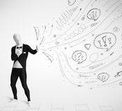 Guy in body suit morphsuit looking at sketches and doodles Royalty Free Stock Image