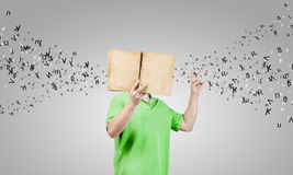 Guy with book Stock Images