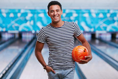 Guy with bowling ball Stock Photos