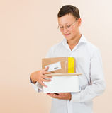 Guy with boxes of parcels. In the hands Stock Images