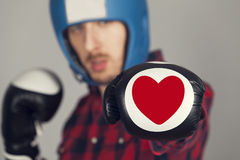 The guy in Boxing gloves with a heart. The boxer is beating by gloves with a heart stock photos