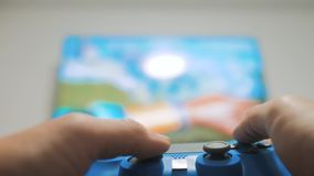 The guy boy is playing on controller joystick gamepad the console computer. lifestyle Playing video games. online games. The guy boy is playing on controller stock footage
