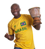 Guy from Brazil with drum is happy about his team Royalty Free Stock Image