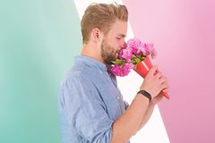 Guy bring romantic pleasant gift waiting for her. Man ready for date bring pink flowers. Boyfriend confident holds. Bouquet waiting for date. Best flowers for royalty free stock photography