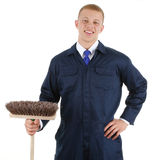Guy with a broom Stock Images
