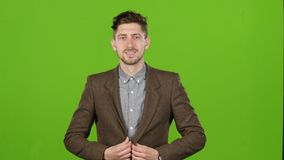 Guy is a businessman, is showing his finger up, admires. Green screen stock footage