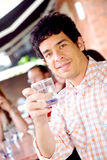 Guy at a cafee having a drink Royalty Free Stock Image