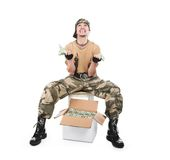 The guy in a camouflage and with a box of money Stock Images