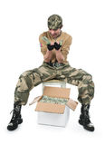 The guy in a camouflage and with a box of money Stock Image