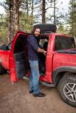Guy on a camping trip. By his truck Royalty Free Stock Photos
