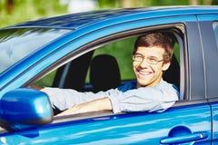 Guy in car closeup Stock Images