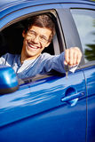 Guy in car with key Royalty Free Stock Image