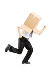 Guy with a cardboard box on his head running away Royalty Free Stock Photos