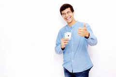 Guy with cards and thumb up sign Stock Photos