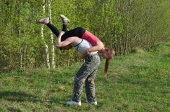 Guy carries a girl on his back Royalty Free Stock Images