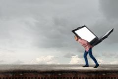 Guy carrying laptop Stock Photo