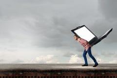 Guy carrying laptop Stock Photo