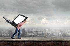 Guy carrying laptop Stock Images