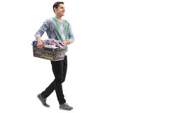 Guy carrying a laundry basket Stock Image