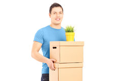 Guy carrying removal boxes during moving into a new house Royalty Free Stock Photography