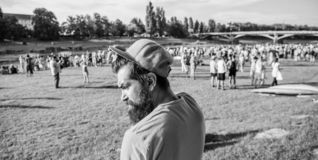 Guy celebrate holiday or festival. Summer fest. Man bearded hipster in front of crowd. Book ticket now. Open air concert. City day. Music festival royalty free stock photography