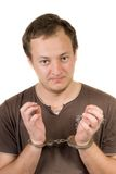 The guy chained in handcuffs. Isolated Royalty Free Stock Images