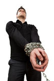 Guy in chains. Isolated on white royalty free stock image