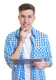 Guy in a checked shirt with his new tablet computer Stock Photos