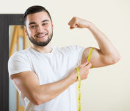 Guy checking fitness results Royalty Free Stock Images