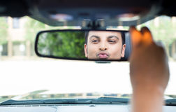 Guy checking himself out in rearview mirror Royalty Free Stock Images