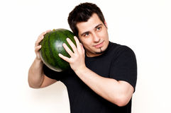 Guy checking watermelon for freshness Royalty Free Stock Photography