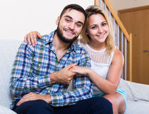 Guy and cheerful pretty girl smiling indoors Stock Photography