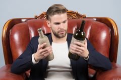Guy choose wine to drink, choice Stock Photo