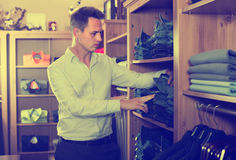 Guy is choosing on new pants Royalty Free Stock Images