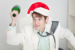 Guy in christmas hat brawls with bottle in hand Stock Images