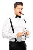 Guy with cigar in his mouth counting money Royalty Free Stock Photography