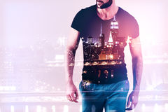 Guy on city background. Front view of casual young guy on city background with copy space. Employment concept. Double exposure Stock Images