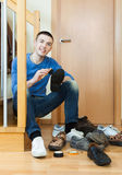 Guy  cleaning footwear Stock Photo