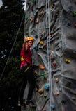Guy Climbing On Wall foto de archivo