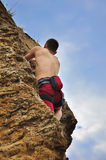 Guy climbing Stock Image