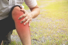 The guy clings to a bad leg. The pain in his leg after exercise. Royalty Free Stock Photos