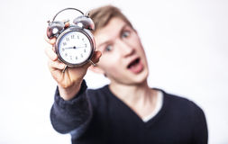 Guy with clock. Royalty Free Stock Photos
