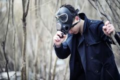 The guy in the coat and gas mask. Post-apocalyptic portrait of A royalty free stock photo
