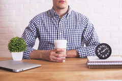 Guy with coffee in hands Stock Photos