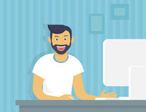Guy with computer. Happy guy working with computer at home Royalty Free Stock Images