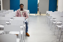 Guy in conference-hall Royalty Free Stock Photo